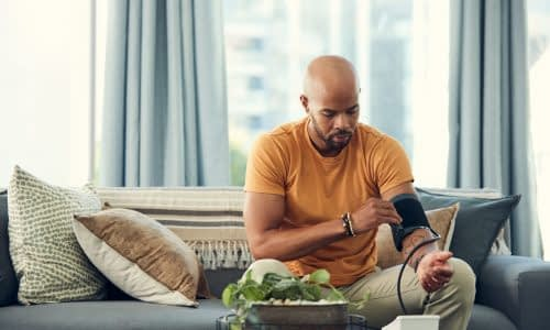 Man taking his blood pressure at home