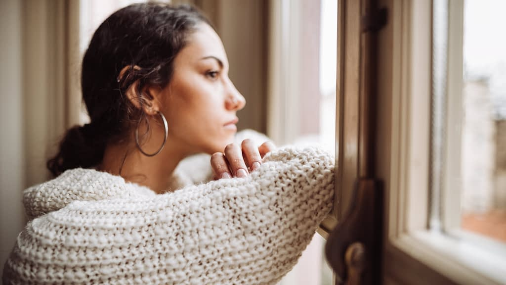 Woman staring pensively out the window