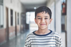 Happy child in school hallway